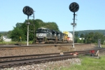 NS 2760 leads a big stack train downhill