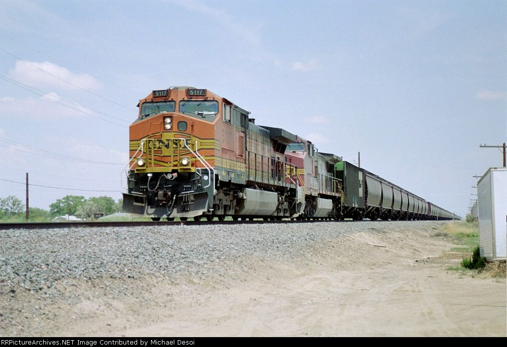 BNSF C44-9W #5117 leads a southbound grain train at Route 116