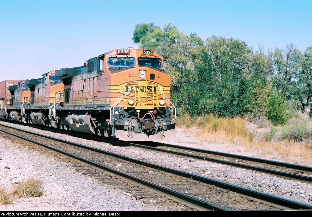 BNSF C44-9W #5395 brings in an eastbound at Impala Rd.