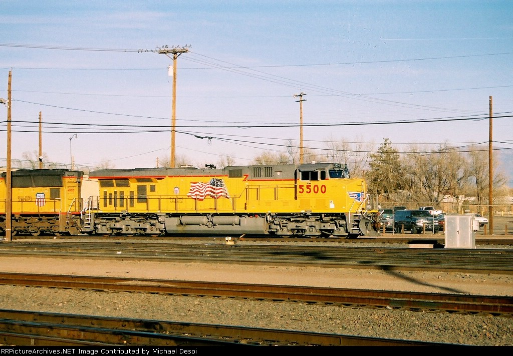 UP ES-44AC #5500 leads an eastbound int the yard