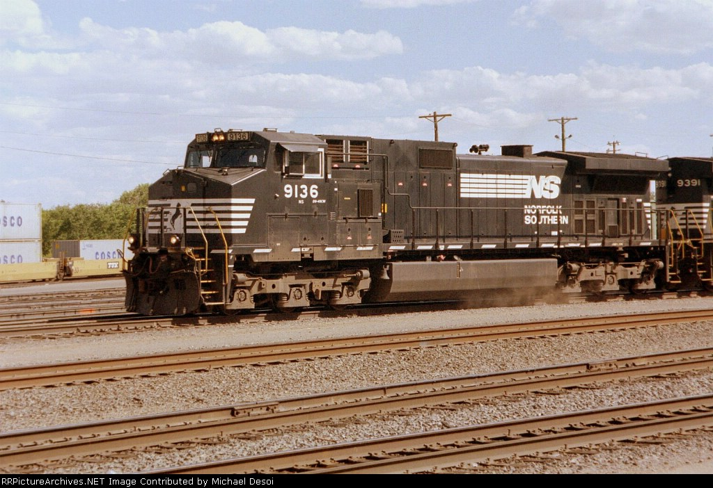 NS C40-9W#9136 leads a westbound out of the yard