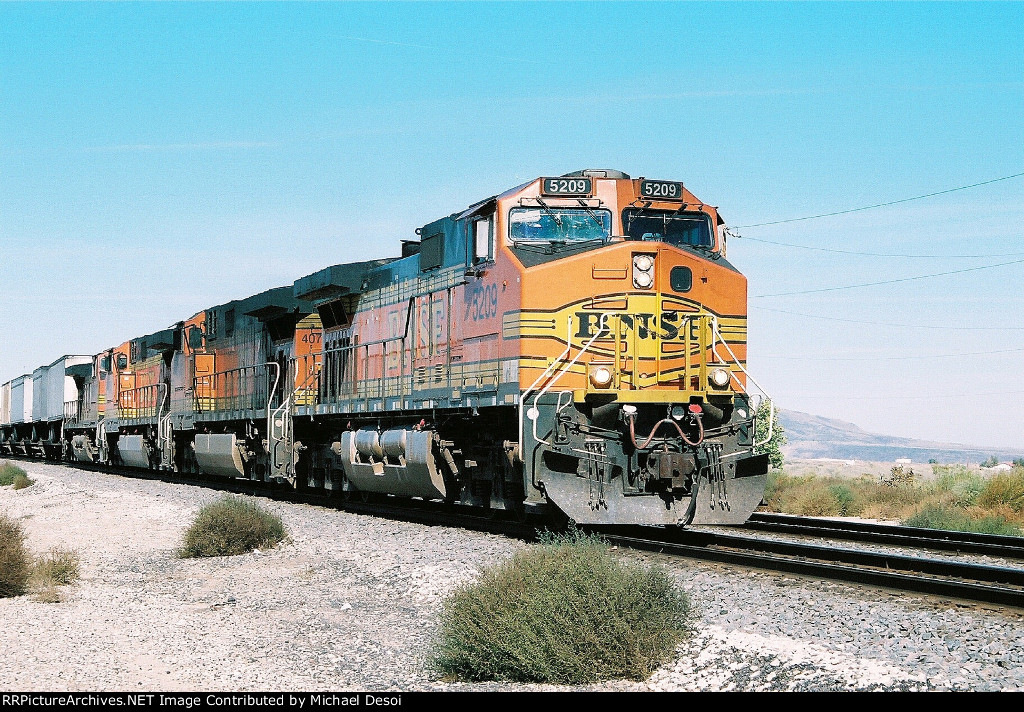 BNSF C44-9W #5209 leads an eastbound at Mesa Rd.