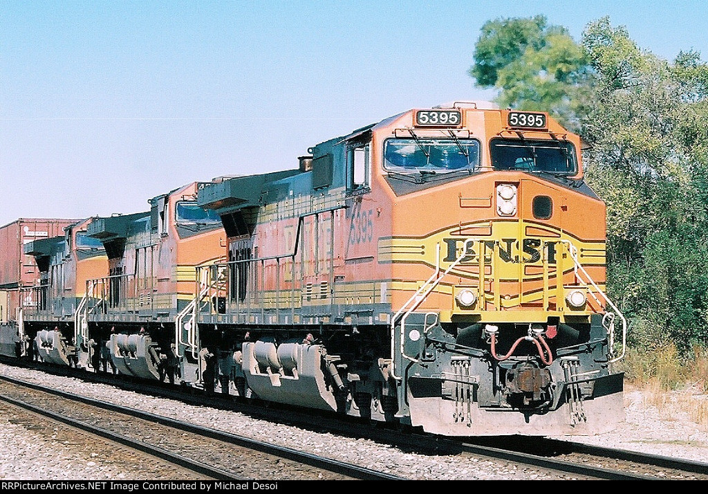 BNSF C44-9W #5395 Leads aneastbound stack train across Impala Rd.