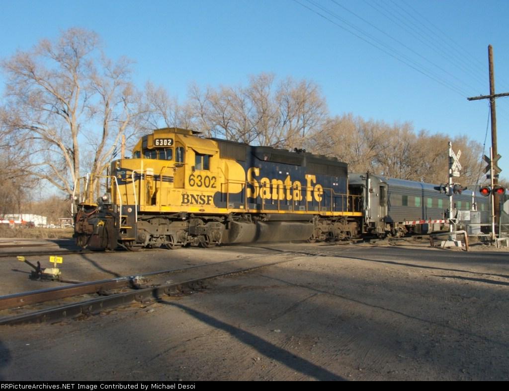 "BNSF 6302 brings the ""test"" train west across Woodward Rd."
