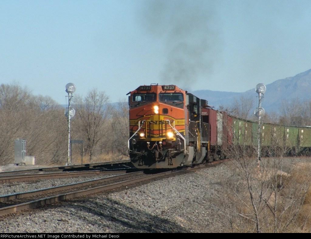 BNSF 4737 heads a westbound grain train at Jarales Rd.