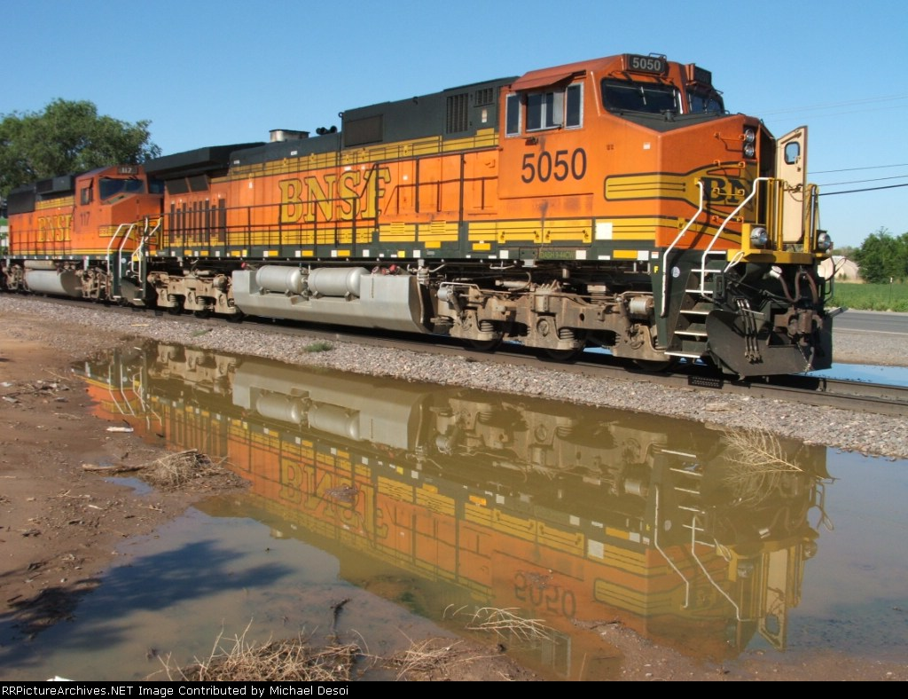 Reflections of..... BNSF 5050 Southbound at 2nd & Prosperity Sts.