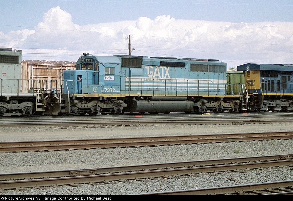 GSCX SD-40-2 #7372 is midconsist of this westbound leaving the yard