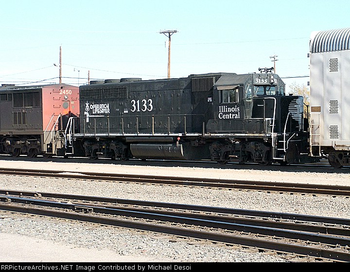 IC GP-40 #3133 is third out on  a westbound consist leaving the yard