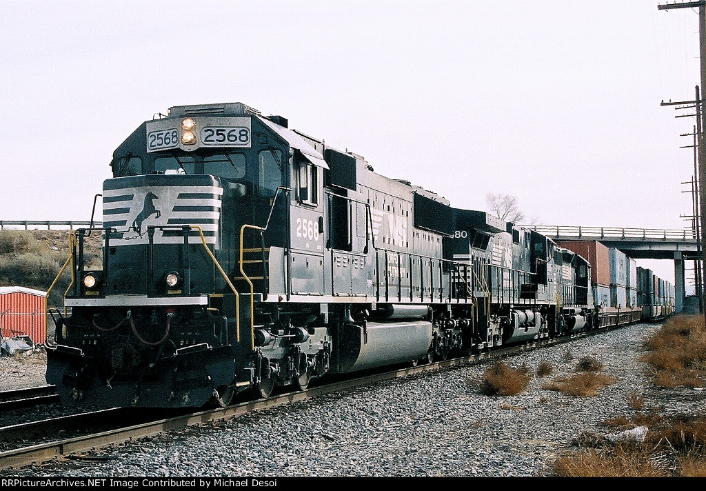 NS SD-70 #2568 leads an all NS lashup with a westbound stacker at Impala Rd.