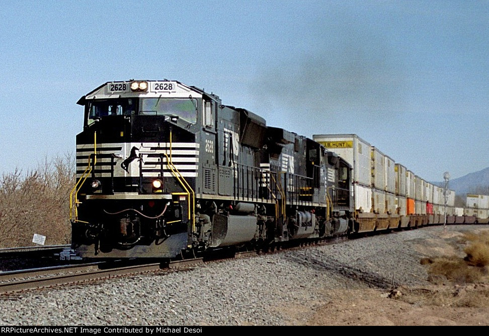 NS SD-70M #2628 leads an all NS lashup with a westbound stacker at Jarales Rd.