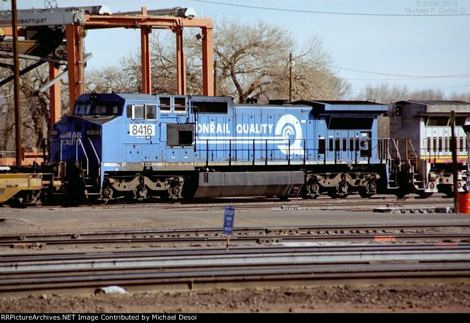 Still wearing Conrail paint, NS C40-8W #8416 is the last of a 4 unit consist on a BNSF eastbound that is just entering the yard in Belen, NM. 2/7/2006