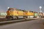 BNSF C44-9W #4372 leads a westbound out of the yard