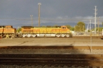 The sun is setting as BNSF C44-9W #4533 leads an eastbound into the yard