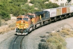 BNSF C44-9W #4564 is pulling hard on this eastbound exiting the canyon. Takne fron the route 6 OHB.