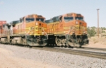 BNSF C44-9W #4593 waits as 4601 passes with an eastbound