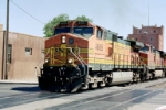 BNSF C44-9W #4605 leads an eastbound across Lomas Blvd.