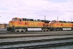 BNSF C44-9W now leads a westbound out of the yard