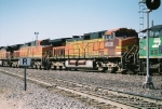 BNSF Patch Job C44-9W #4938 is mid consist on a westbound at Ross Ave.