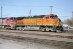 BNSF C44-9W #5042 brings an eastbound into the yard