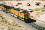 BNSF C44-9W #5090 handles an eastbound at the still abuilding Railrunner Station (taken from US 550 OHB)