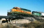 BNSF SD-40-2 #7035 leads the southbound Belen Turn over the dry wash south of Desert Rd.