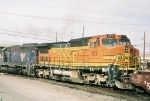 BNSF C40-8W #809 in a later pic shows a noticable sag in its frame.  Unit is westbound out of the yard