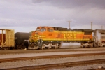 BNSF C40-8W #809 leads a westbound out of the yard