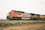BNSF C40-8W #869 leads an eastbound just west of Rio Puerco