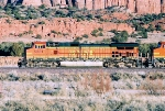 BNSF C44-9W #5331 leads an eastbound past the red rocks at the AZ. N.M. Border