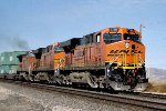 BNSF ES-44DC #7788 leads an eastbound stacker across Mesa Rd.