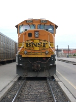 BNSF 9900 sits with an eastbound coal train at the passenger station