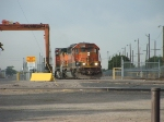 BNSF 7033 works the trailer yard at Woodward Rd.
