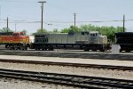 """Ahh, The Primer Years""  NS C40-9W #9909 is the second unit on a BNSF eastbound, entering the yard in Belen, NM. 2005"