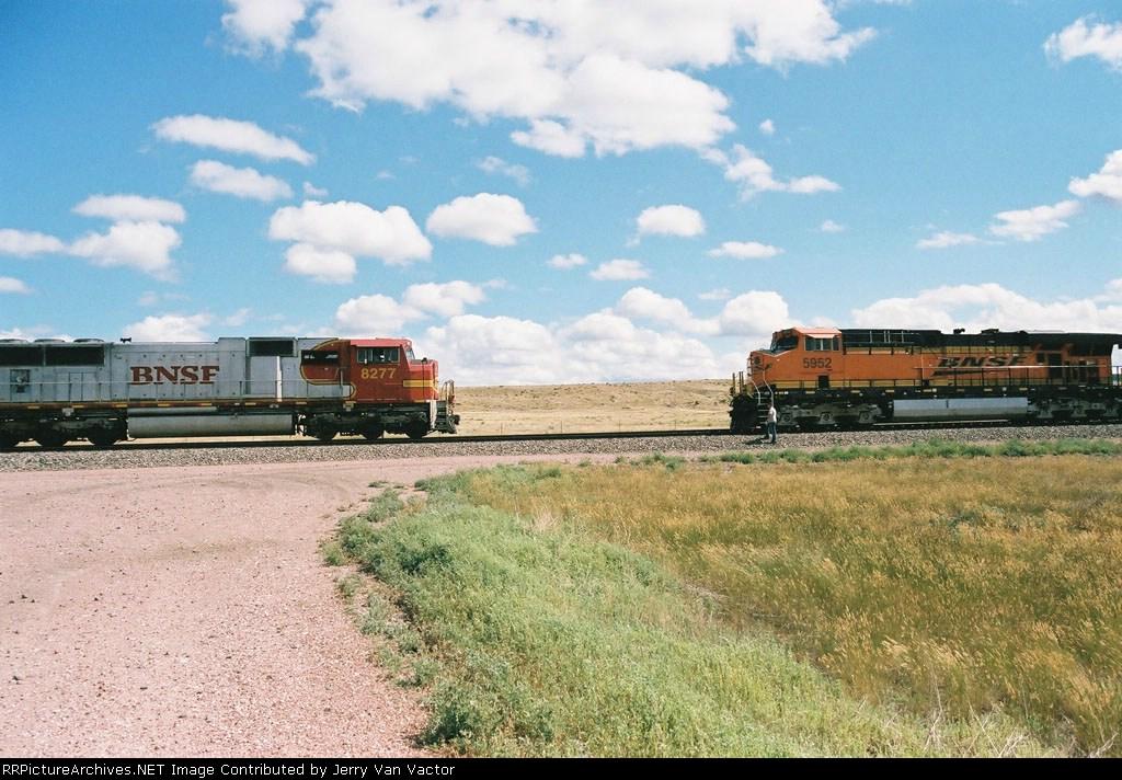 BNSF 8277 wb local meets stopped eb BNSF 5952 unit coal train