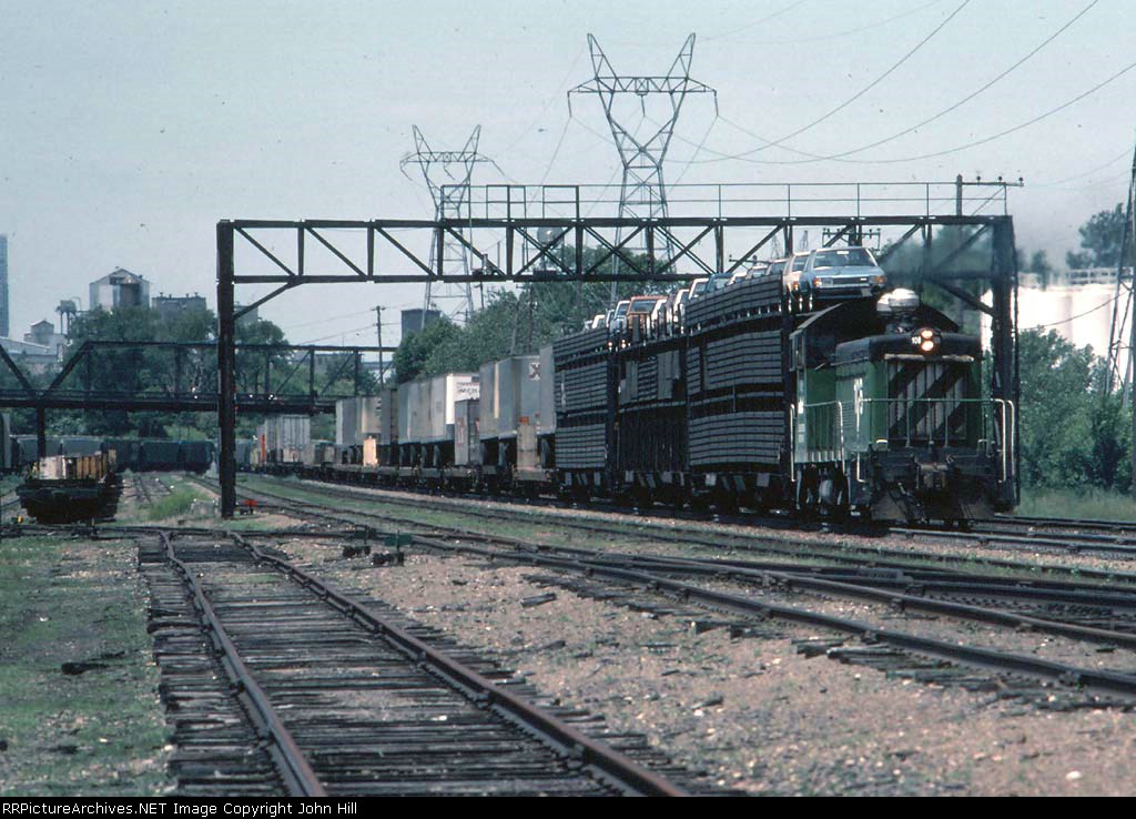 1235-21 Eastbound BN local freight passes St. Anthony junction and M&M Yard