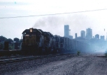1236-33 Eastbound C&NW passes BN ex-GN M&M Yard near St. Anthony Junction