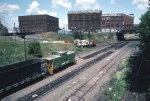 1244-30 Coal train on BN at ex-GN First Street North (Hole in the wall)