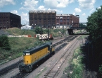 "1244-37 C&NW 4193 rolls through while SOO ""Railway"" job waits at BN ex-GN at First Street North (Hole in the wall)"