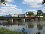 Framed by the riverside vegetation, 24 leads its train over the Grand River