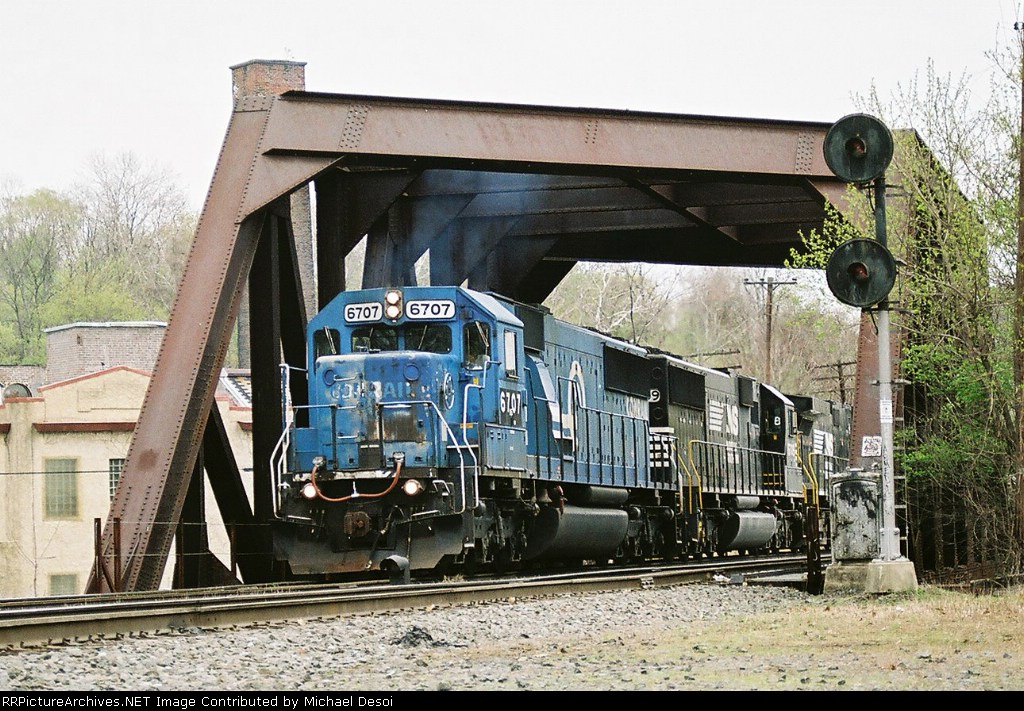 NS SD-60 #6707 still in CR Blue leads a westbound across the Lehigh Canal Bridge at Canal Park