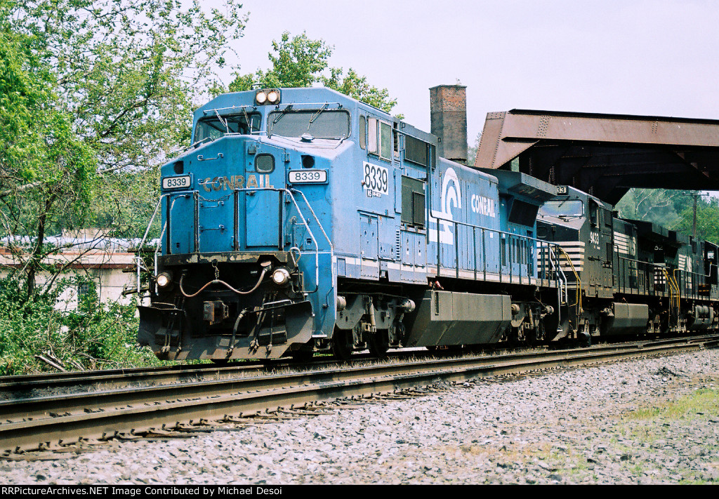 NS C40-8W #8339 leads a westbound out of the yard