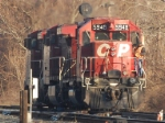 CP 5948 drifts back to iys train at CP JU