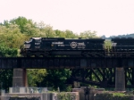 NS OLS C40-9W #9250 is on the ex LHR bridge with a Portland bound coal train