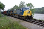CSX AC-6000CW #696 leads a westbound through the station