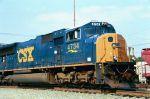 CSX 4734 leads a manifest train NB through a clear signal at North Collier Yard,