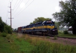 DME 6055 is westbound on main track east of Waseca yard.