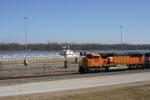 BNSF 9989 passes by the C. Michael Reeves at Lock & Dam 24.