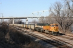 BNSF 8915 passing under I 72/36 and hitting the NS Xing on its way south.