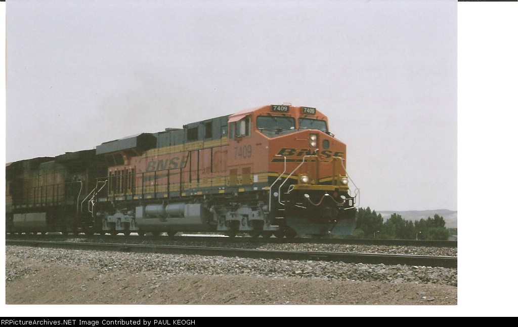 BNSF 7409 rolls west with a UP crew at the controls towards Sparks, Nv.
