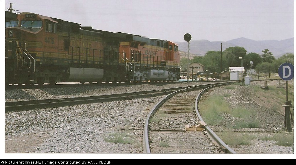 BNSF 7409 rolls west past me towards Sparks, Nv for a UP crew change.